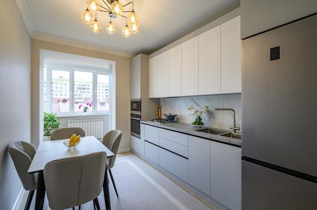 Interior de cocina moderno gris y blanco Foto Premium