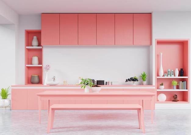 Interior de cocina con pared de color coral vivo.