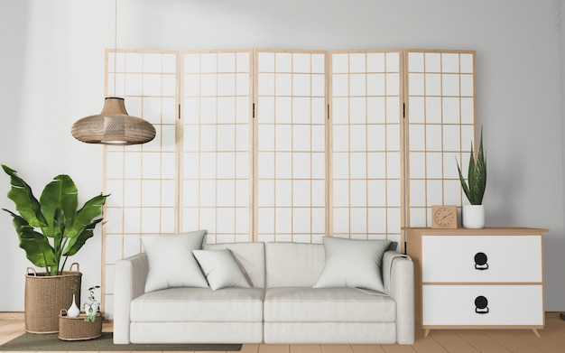 Interior de la habitación tropical con decoración de sofá y plantas en piso de madera