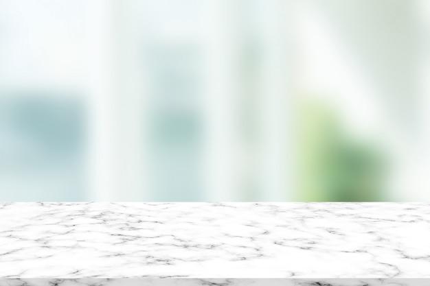 Interior moderno borroso abstracto con superficie de mármol para mostrar producto en concepto de visualización