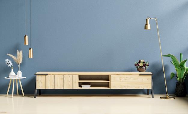 Interior moderno de la sala de estar con mueble para tv sobre fondo de pared azul oscuro, representación 3d