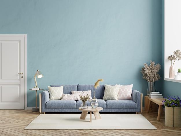 Interior moderno de la sala de estar con sofá oscuro en la pared azul oscuro. representación 3d