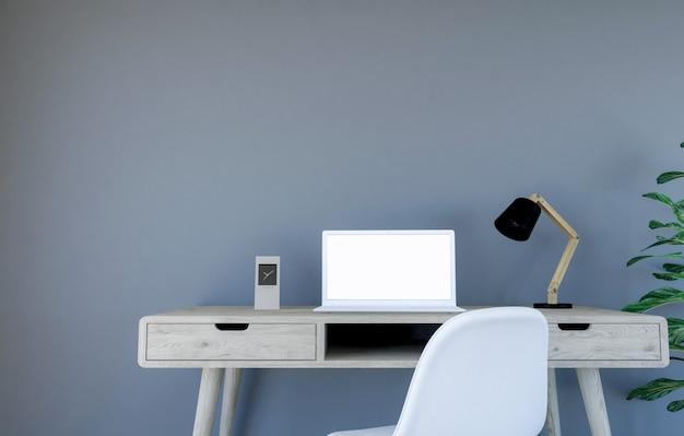 Interior de la sala de estar contemporánea con pared gris y mesa de trabajo con computadora portátil