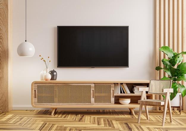 El interior de la sala de estar tiene mueble de televisión y una silla en la habitación blanca. representación 3d