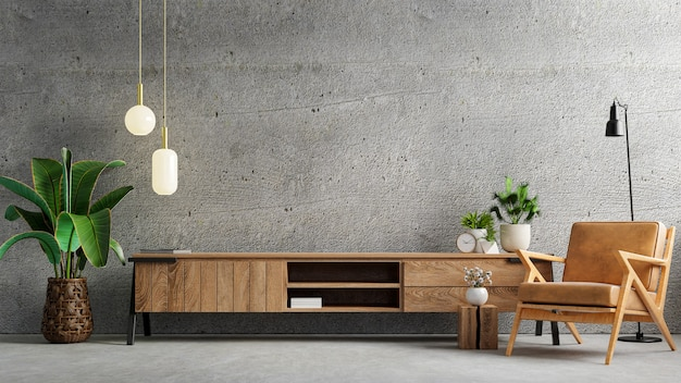 El interior de la sala de estar tiene un mueble para tv y un sillón de cuero en una sala de cemento con una pared de concreto.