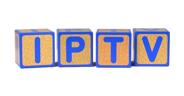 Iptv en bloque de alfabeto infantil de madera coloreado aislado en blanco.