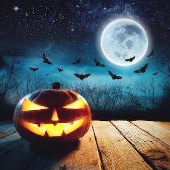 Un jack o lantern brillante en un bosque de niebla oscura en halloween