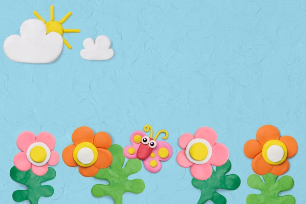 Jardín de flores con textura de fondo en artesanía de arcilla de plastilina azul para niños