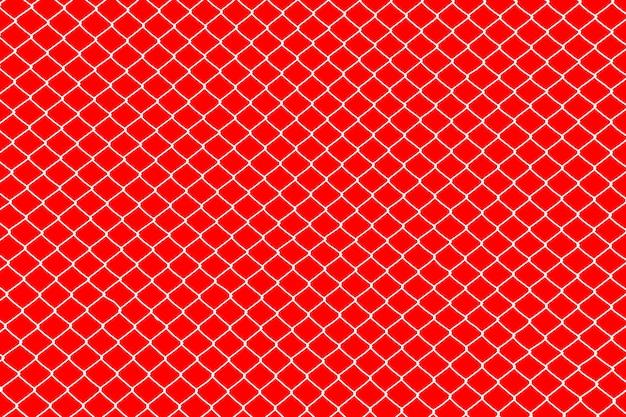 Jaula blanca de alambre de metal sobre fondo rojo