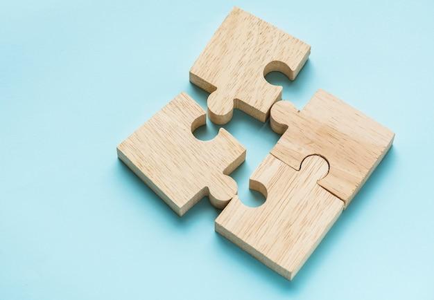 Jigsaw trabajo en equipo concepto macro tiro