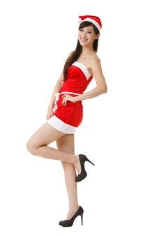 Joven asiática de navidad, retrato de cuerpo entero aislado sobre fondo blanco.