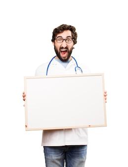 Joven médico con un cartel