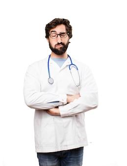 Joven médico hombre aburrido expresión