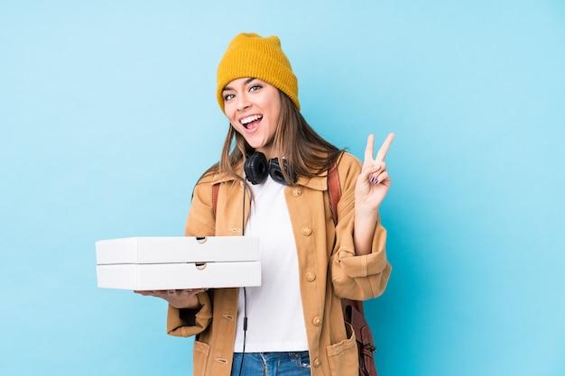 Joven, mujer caucásica, tenencia, pizza
