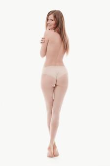 Joven mujer posando topless, piel perfecta, vista posterior
