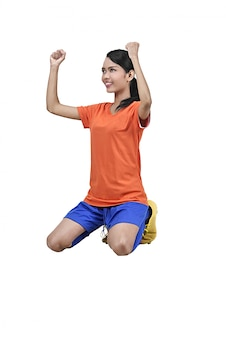 El jugador femenino asiático del fútbol de la felicidad celebra