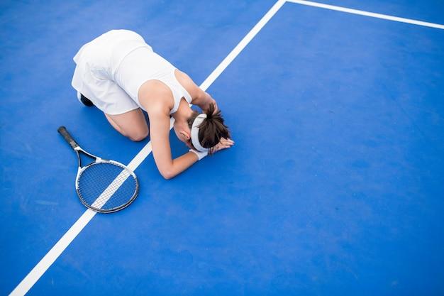 Jugadora de tenis agotada
