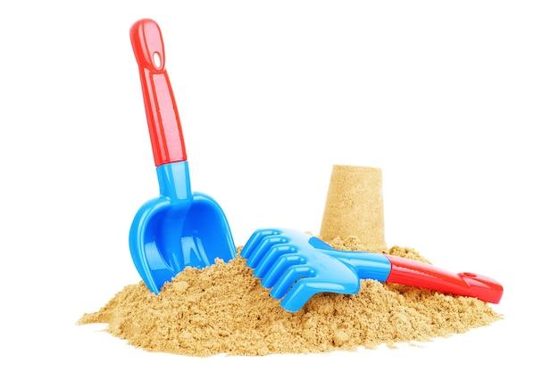 Juguetes para niños de plástico brillante en la arena concepto de recreación en la playa para niños