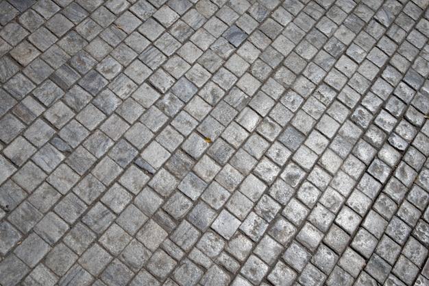 Ladrillo gris piedra calle camino. textura del pavimento