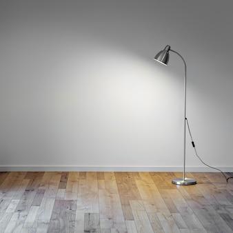 Lámpara de pie de metal en una habitación vacía con sombra en la pared blanca, copia espacio para texto