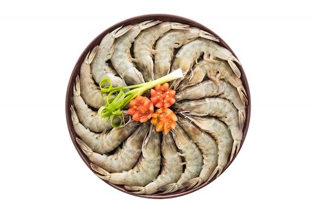 Langostinos crudos y camarones en plato