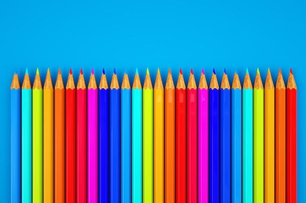 Lápices de colores gráficos 3d. imagen con un juego de lápices de colores. de cerca. juego de lápices de colores en fondo azul.