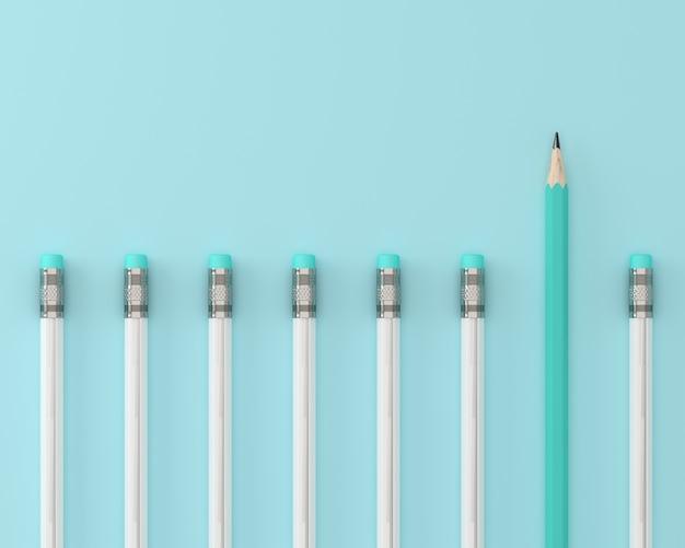 Lápiz azul y lápiz blanco sobre fondo azul pastel