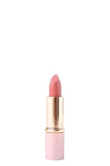 Lápiz labial rosa aislado sobre fondo blanco.