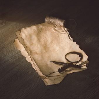 Lápiz de tinta y hilo de lino en papel quemado