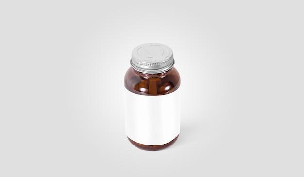 Lata de píldora de vidrio ámbar en blanco con etiqueta blanca sobre gris
