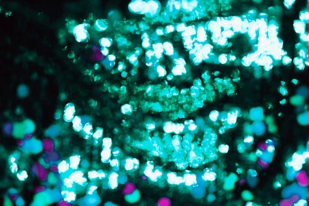 Lentejuelas verdes borrosas en el fondo