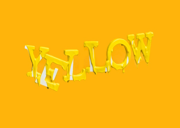 Letras flotando formando la palabra yellow con pintura cayendo