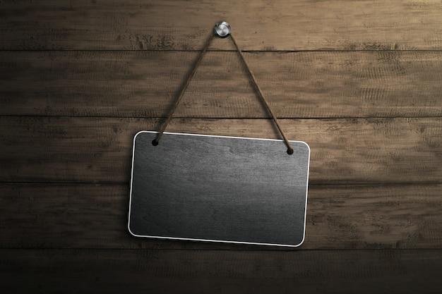 Letrero en blanco para el área de copyspace colgando con una cuerda y un clavo
