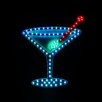 Letrero de neón en bar con imagen de cóctel.