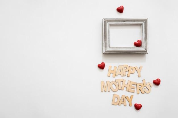 Lettering de feliz día de la madre, marco y corazones