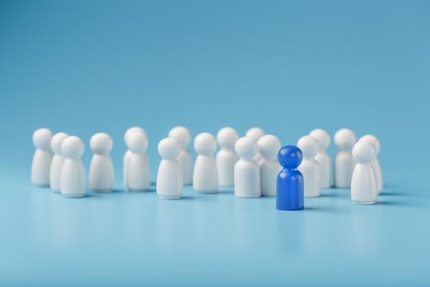 El líder en azul lleva a un grupo de empleados blancos a la victoria, rrhh, reclutamiento de personal. el concepto de liderazgo.