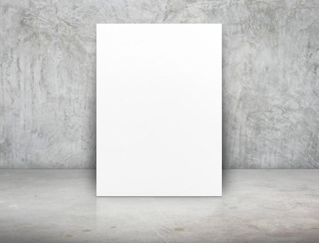 Lienzo de cartel de papel blanco en blanco en la sala de concreto de grunge