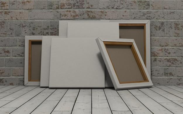 Lienzos en blanco en pared de ladrillos