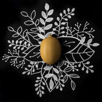 Limón sobre contorno floral dibujado a mano