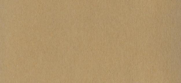 Limpiar la textura de fondo de papel de cartón kraft marrón. cartón vintage
