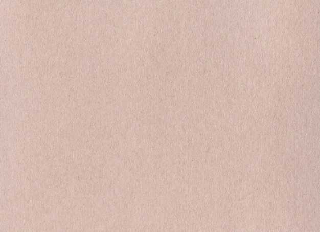 Limpie la textura de fondo de papel de cartón kraft marrón. papel pintado de cartón vintage