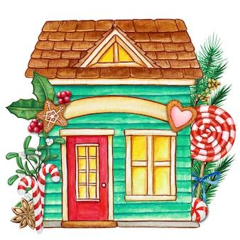 Linda casa de navidad de acuarela con golosinas