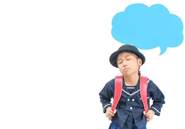 Linda chica estudiante en uniforme escolar japonés aburrido y pensando
