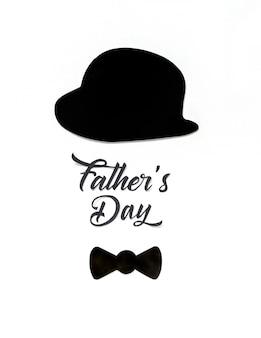 Lindo cartel con sombrero negro y corbata de lazo para el mejor papá sobre fondo blanco.