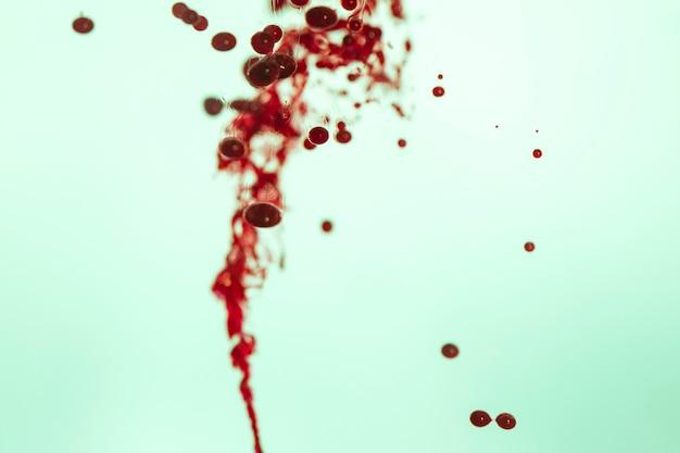 Línea abstracta de glóbulos rojos borrosos