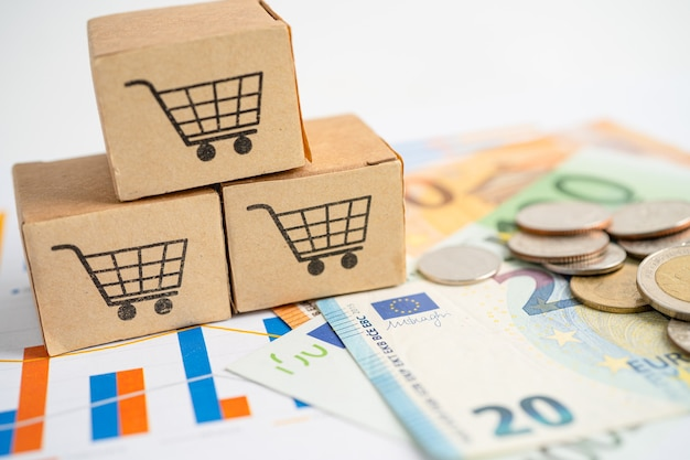 Logotipo del carrito de compras en la caja con billetes en dólares estadounidenses inversión en cuenta bancaria