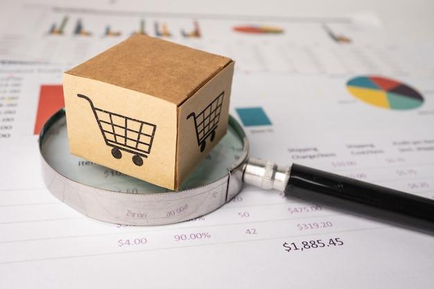 Logotipo de carrito de compras en caja con lupa en gráfico