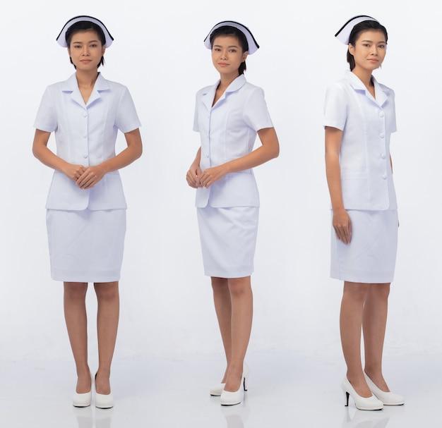 La longitud del cuerpo completo figura snap de la mujer asiática de los años 20 desgaste uniforme blanco de enfermera falda y zapatos, fondo blanco aislado