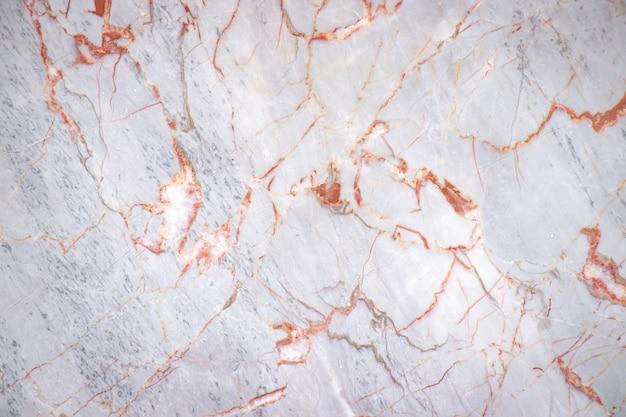 Losa de mármol agrietada blanca con fondo de textura de patrón de color cobre, detalle del antiguo piso de arquitectura