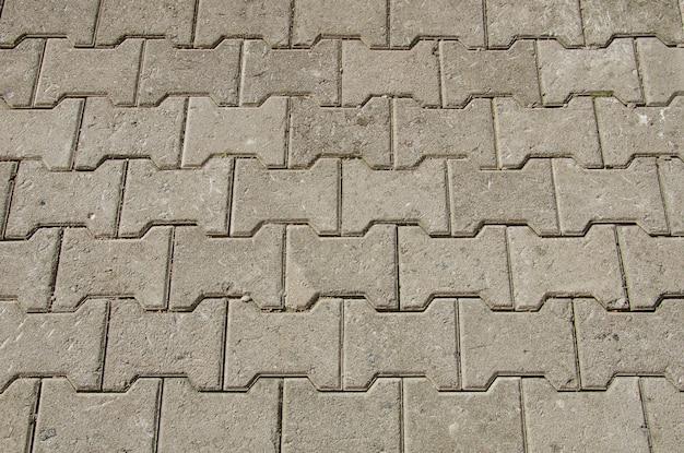 Losas de pavimentación con figuras grises